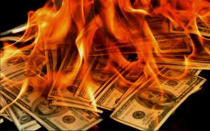 Burning money.